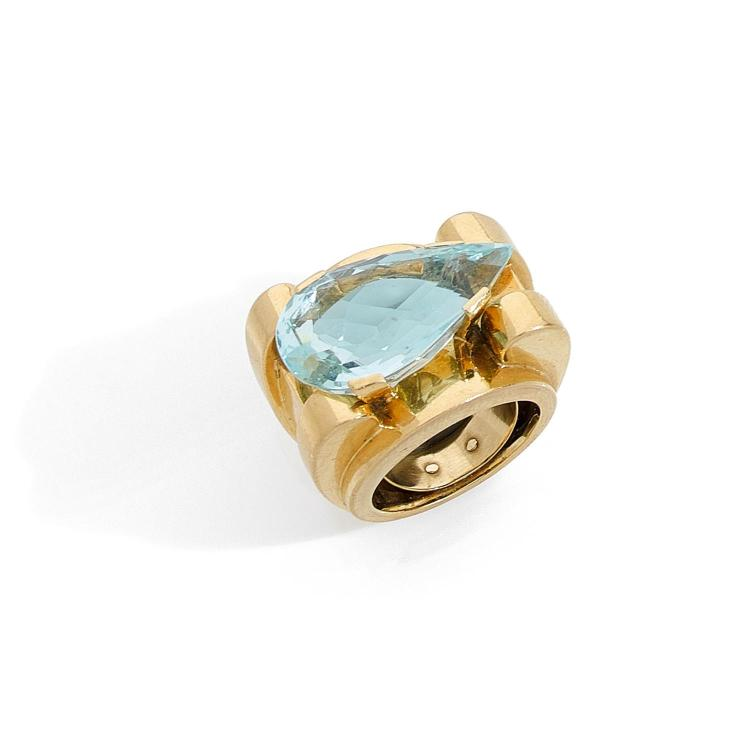 An aquamarine and gold ring, circa 1960.