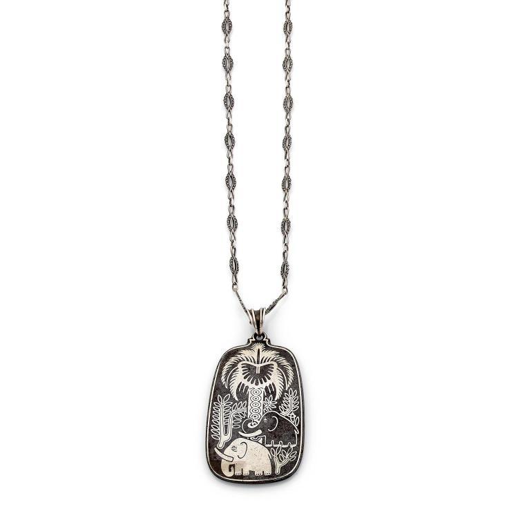 ARNO MALINOWSKI pour GEORG JENSEN ANNEES 1935 A silver and steel pendant by Arno MALINOWSKI for GEORG?JENSEN, circa 1935.