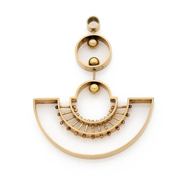 A gold pendant, circa 1960.