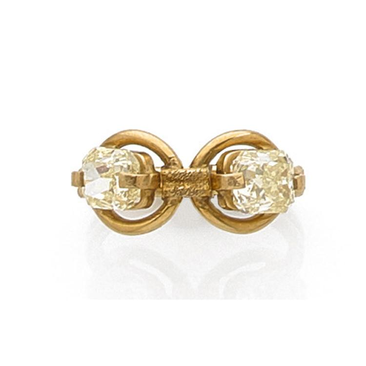 A yellow diamond and gold ring, circa 1970.