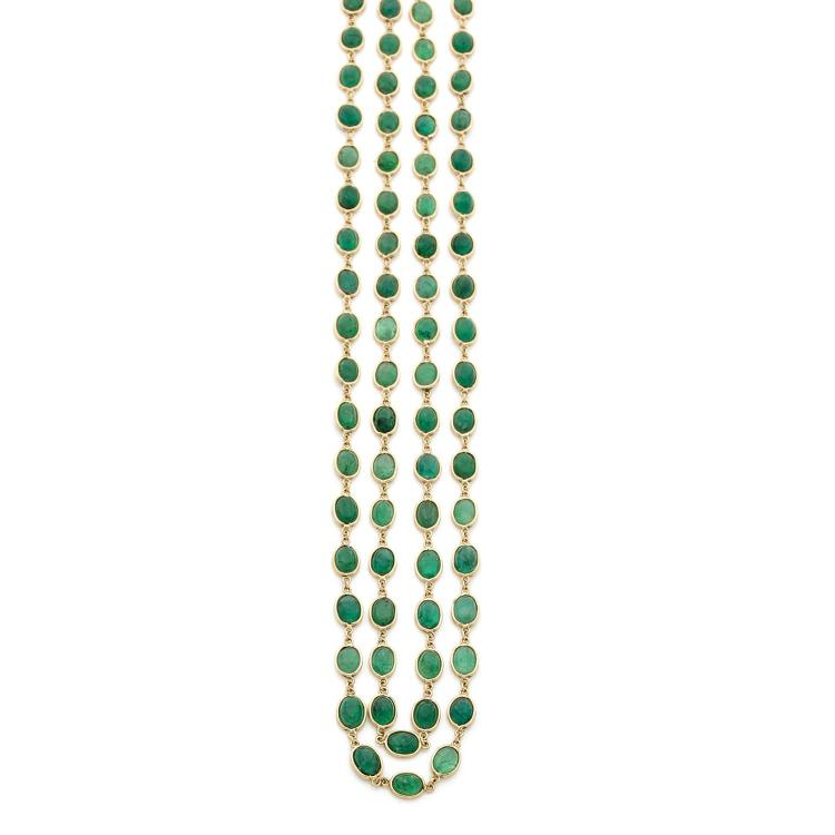 An emerald and gold long chain.