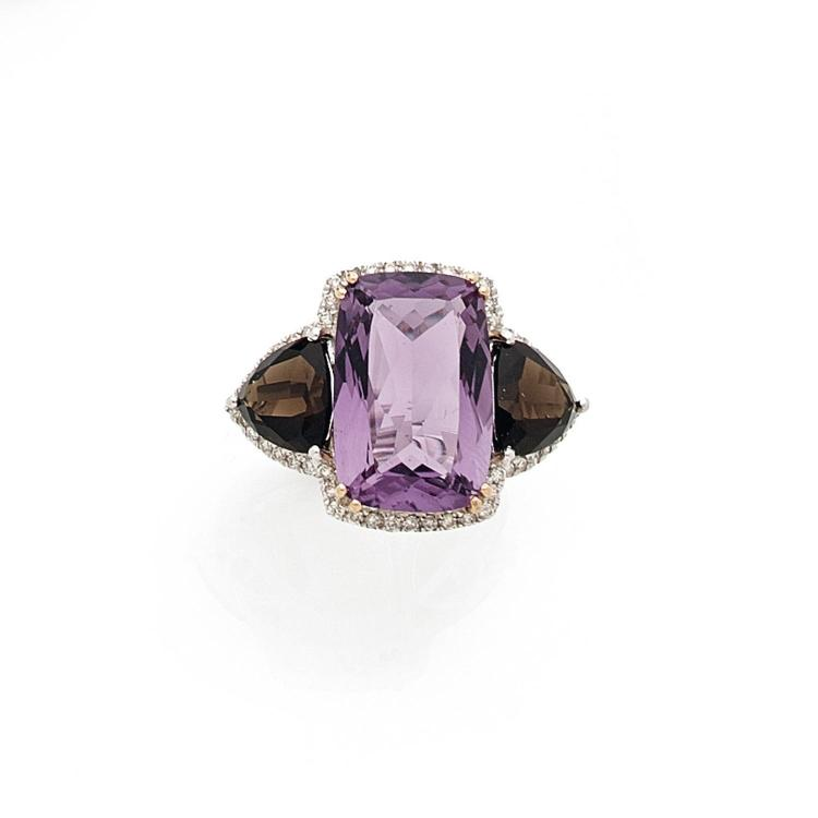 An amethyst, quartz, diamond and gold ring.