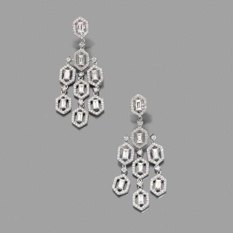 A diamond and gold ear pendants.