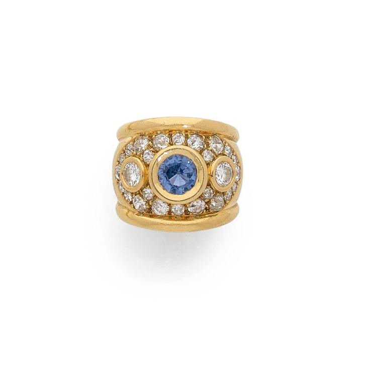 A sapphire, diamond and gold ring.