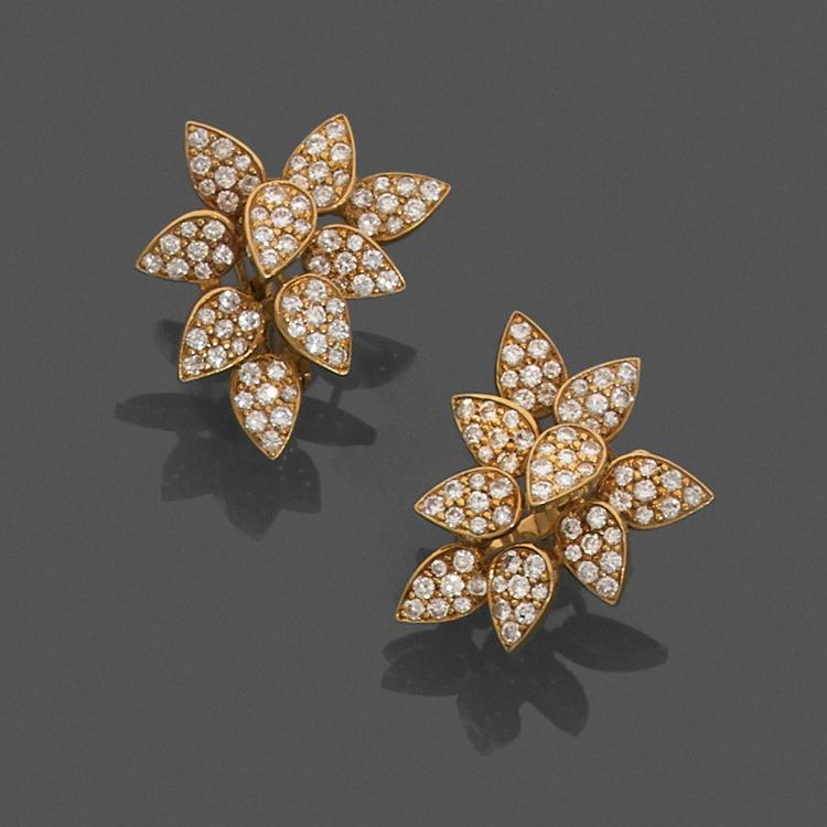 A diamond and gold pair of ear pendants, circa 1970.