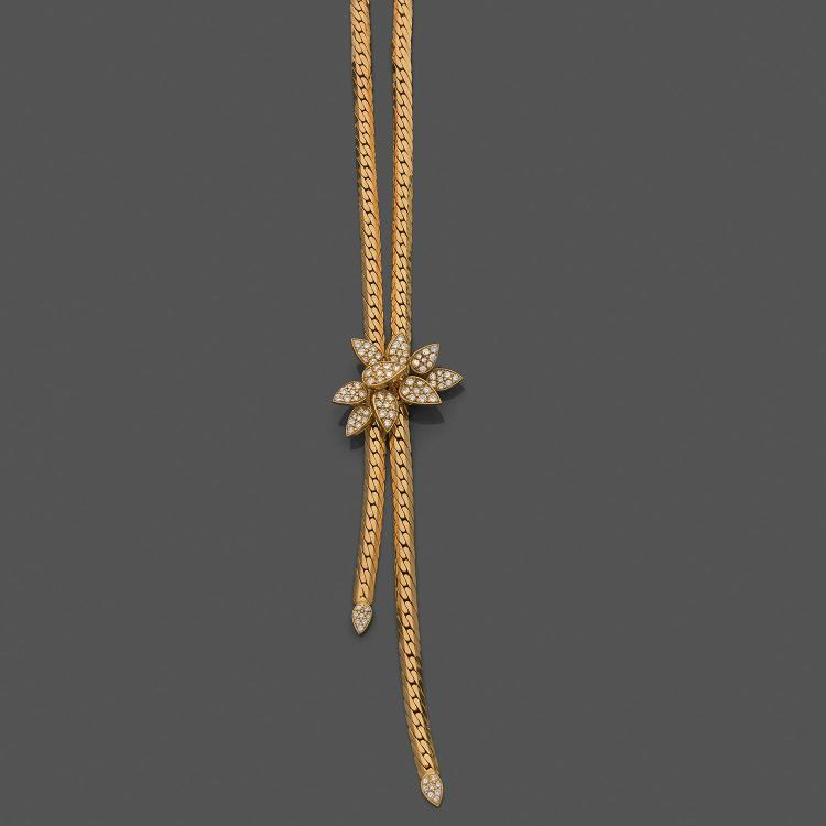 A diamond and gold long necklace, circa 1970.