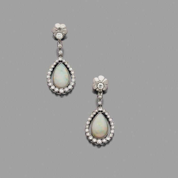 An opal, diamond and gold ear pendants.