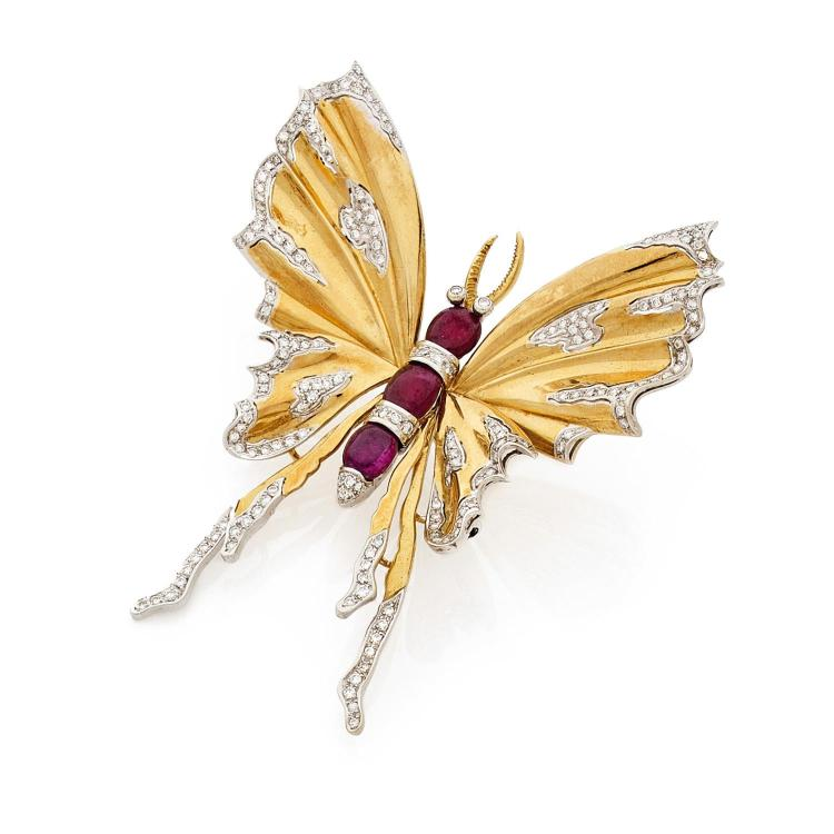 A ruby, diamond and gold brooch, circa 1980.