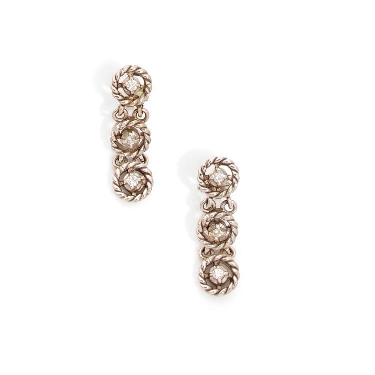 A diamond and gold ear clips, circa 1960.