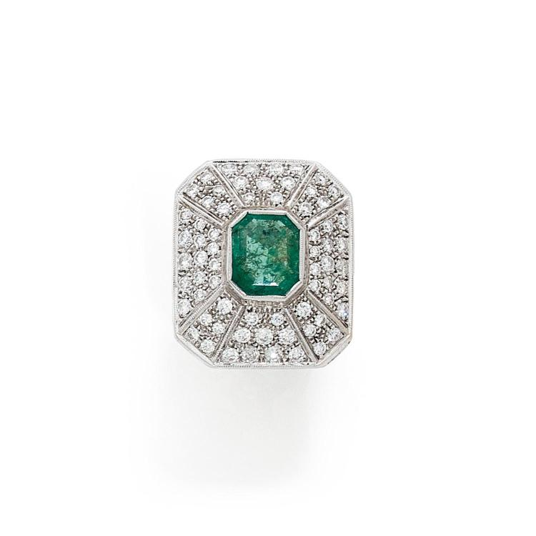 An emerald, diamond and gold ring.