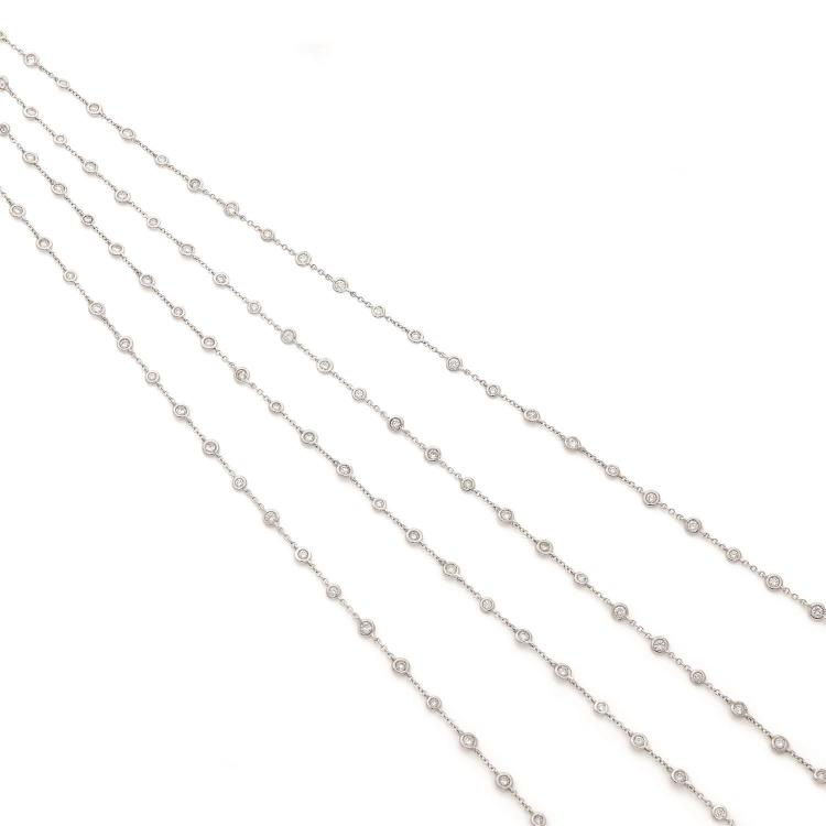 A diamond and gold long chain.