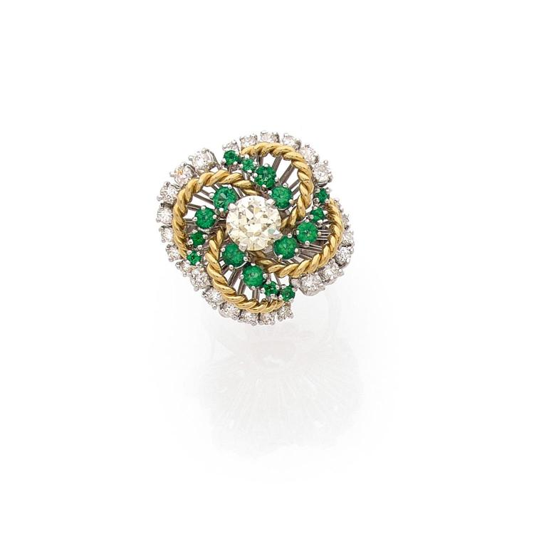 A diamond, emerald and gold ring.