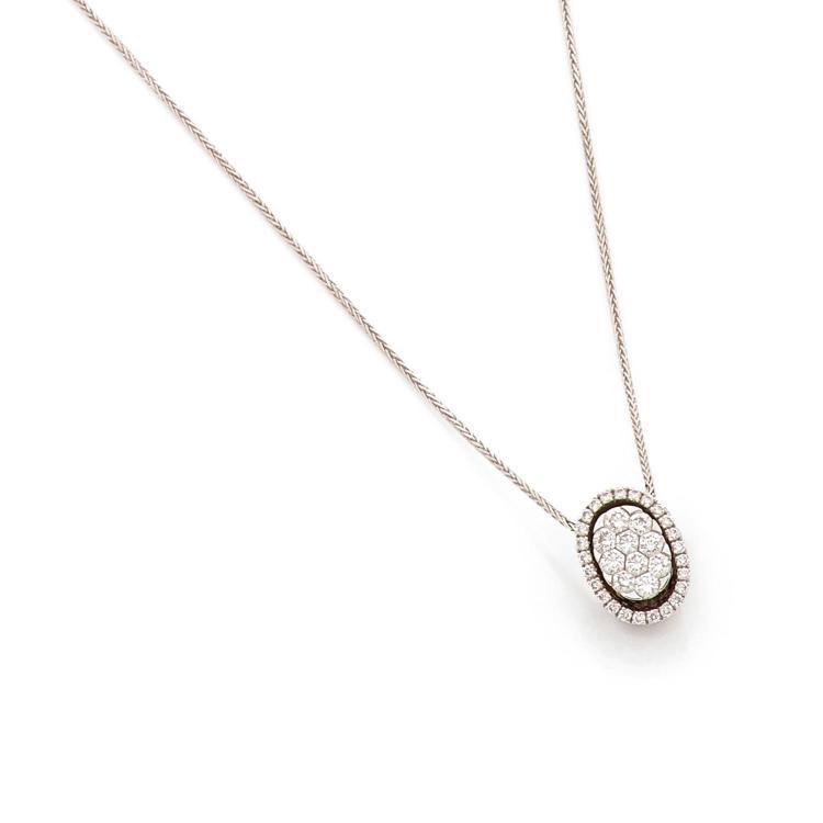 A diamond and gold pendant with chain.