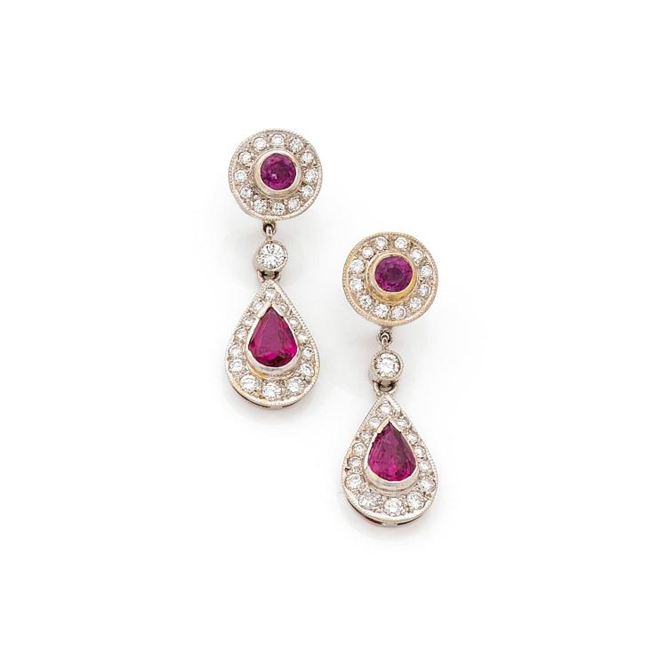 A ruby, diamond and gold pair of ear pendants.