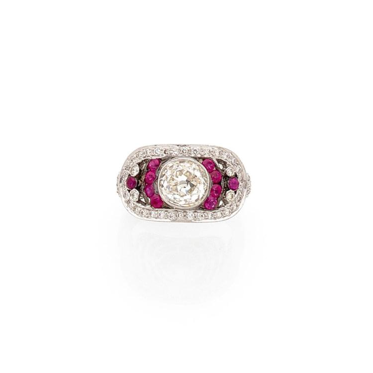 A 1,97 carat diamond, ruby and gold ring.