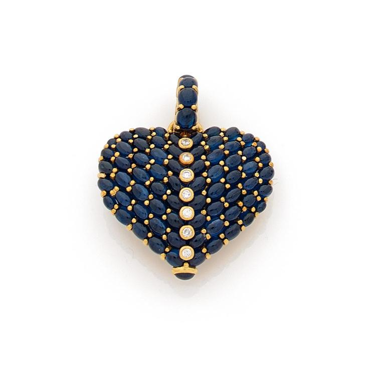A sapphire, diamond and gold pendant.