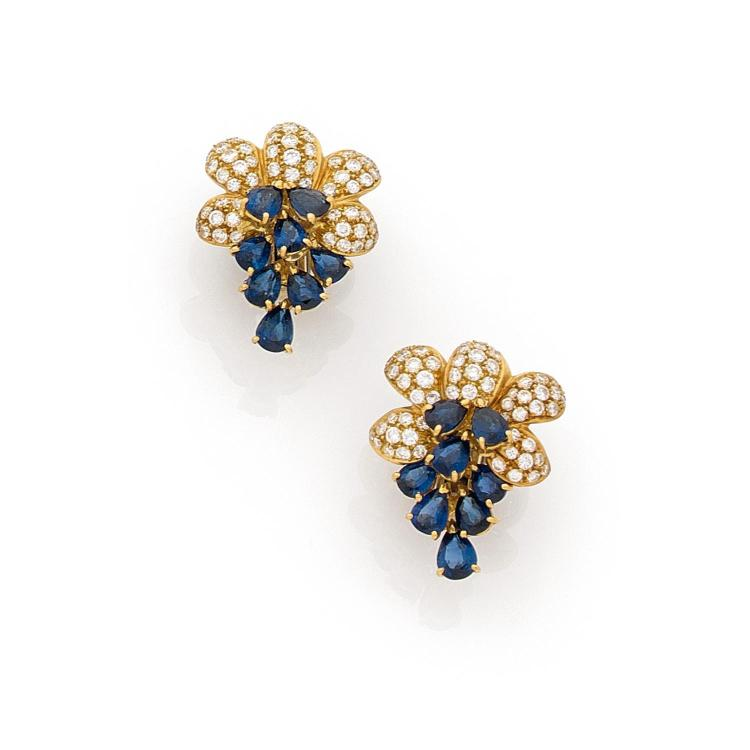 A sapphire, diamond and gold pair of ear clips.
