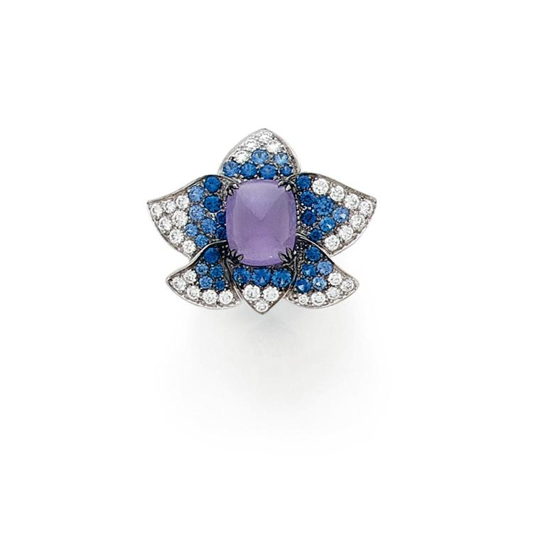 A jade, diamond, sapphire and gold ring.