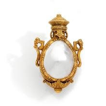 A gold perfume bottle, circa 1840-1850.