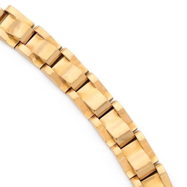 A gold bracelet, circa 1940.