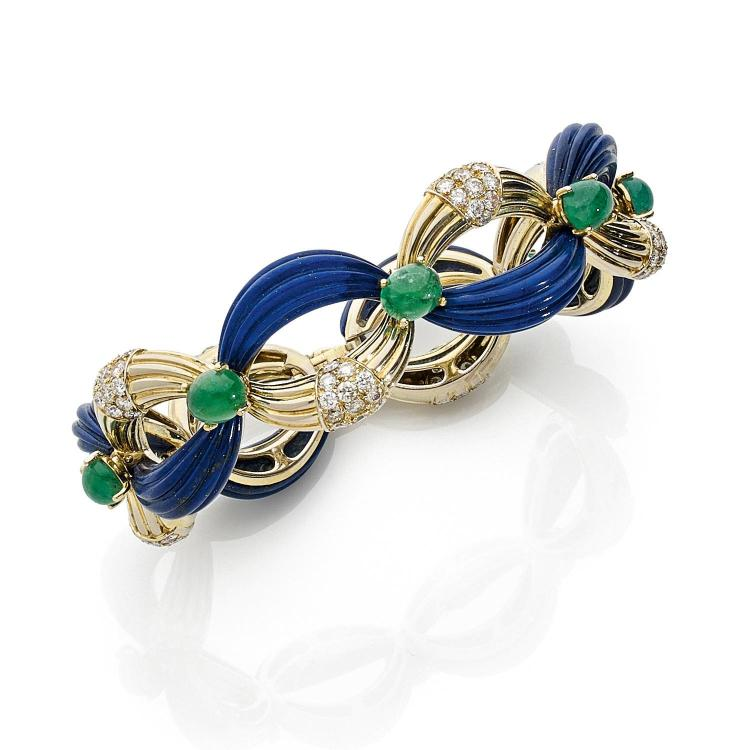 FRED ANNEES 1970 A diamond, emerald, lapis lazuli and gold set by FRED, circa 1970.
