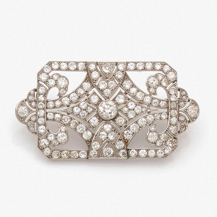A diamond, platinum and gold brooch, circa 1920.