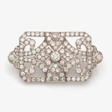 A diamond, platinum and gold brooch, circa 1920.