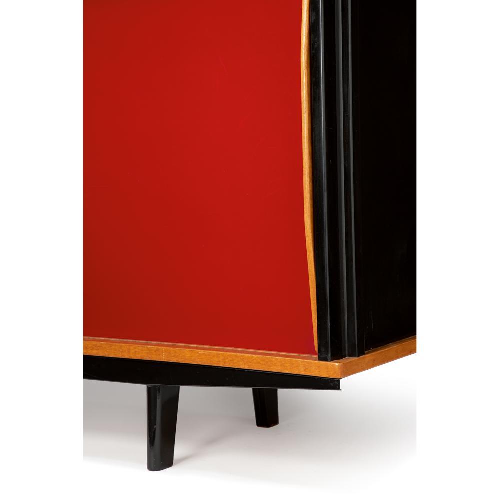 JEAN PROUVÉ (1901-1984) Bahut, modèle BA12, 1948, structure en tôle d'acier pliée relaquée noir, chêne et placage de chêne, deux v...