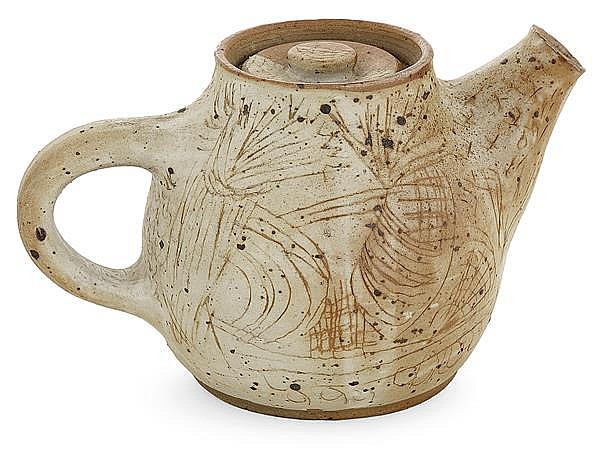 VASSIL IVANOFF (1897-1973) A scarificated earthenware ovoid teapot. Carved signature. Height. 11 3/4 in. - max Lenght. 8 1/2 in.