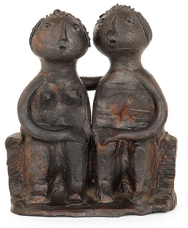 Dominique POUCHAIN (Né en 1956) A black enamelled stoneware sculpture representing a seated couple. Carved signature. (Two small chips,
