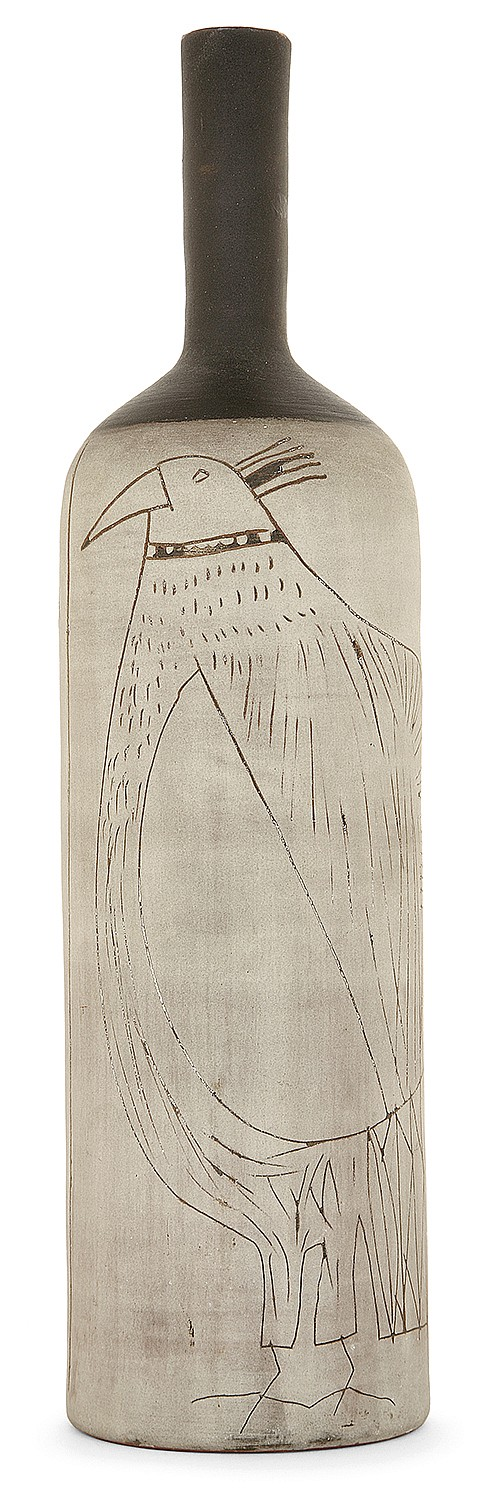 Jacques INNOCENTI (1926-1958) A gray and black slip on ared paste bottle decorated with carved stylised birds. Signed. Height. 13 3/8 i