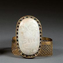 A gilt-copper and jade box and cover, China, early 20th century. L. 4 3/16 in. - H. 2 3/8 in.