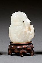 A jade pendant, China, early 20th century. H. 2 1/16 in.