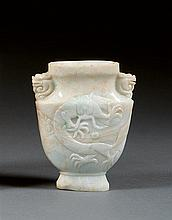A jadeite vase, China, early 20th century. H. 4 7/16 in.