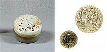 Three jade and serpentine pendants and box and cover, China, 20th century. D. 3 in.
