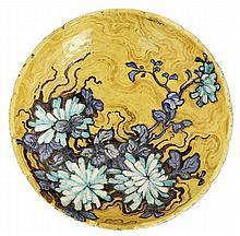 Edmond LACHENAL (1855-1948) A circular enamelled earthenware plate