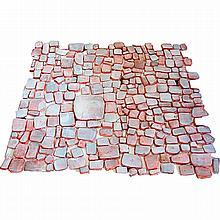 JULIETTE DEREL (1918-2007)Ensemble comprenant environ deux cent quatre-vingts carreaux artisanaux en terre rouge, forme libre rectan...