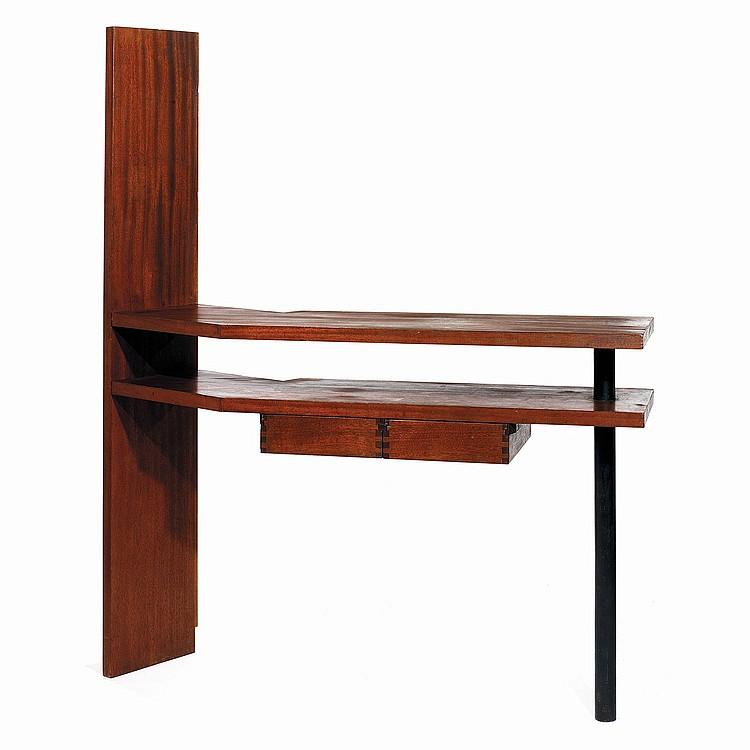 ANDRÉ MAISONNIER (1919-2016) Bureau moderniste en bois exotique teinté à structure asymétrique, le haut montant principal à attach...