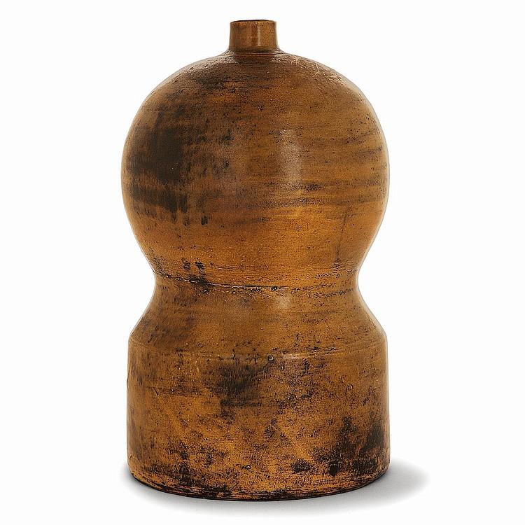 JACQUES BLIN (1920-1995) Pied de lampe en faïence, corps cylindrique surmonté d'une sphère, émaux ocre jaspé, patine noire. Signat...