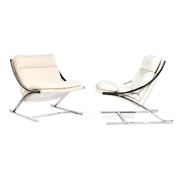 PAUL TUTTLE (1918-2002) & STRASSLE INTERNATIONAL (ÉDITEUR)Paire de fauteuils, lames d'acier chromé formant arcs de cercle successifs...