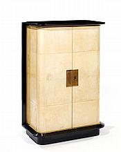 JACQUES ADNET (1900-1984.A rare stained wood and original parchment cabinet, bronze ornaments and keyhole, upper black opalin top, 1937