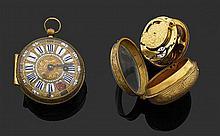 J. GORET à AMIENS VERS 1700 Montre oignon époque Louis XIV en métal doré. Cadran avec index chiffres romains peints sur émail dans d...