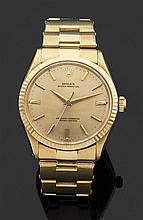 ROLEX OYSTER PERPETUAL. Réf. 1022, VERS 1964 Montre bracelet en or jaune. Cadran doré avec index bâtons appliqués, aiguilles dauphin...