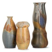 EUGÈNE LION (1867-1945) A set of three stoneware vases