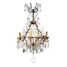 LUSTRE CAGE DE STYLE LOUIS XV, ATTRIBUÉ À BAGUÈSà huit bras de lumière en bronze agrémenté de pendeloques, pinacles et fleurettes en...