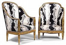 Paul FOLLOT (1879-1933) Suite de deux grandes bergères, à structure corbeille en bois stuqué et doré sur assiette rouge, piétement f...