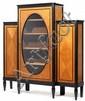 ANDRÉ GROULT (1884-1967) Grande vitrine, structure en frêne et bois noirci, piétement ovoïde bagué en ressauts à l'avant, piétement ...