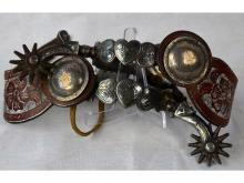 PAIR OF SILVER MOUNTED HEART PATTERN SPURS WITH TOOLED LEATHER STRAPS