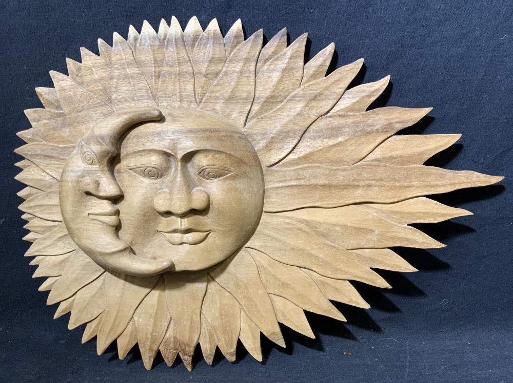 Carved Sun and Moon on Wood