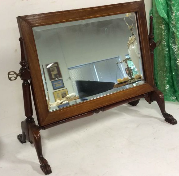 Vintage vanity and attached tilting mirror